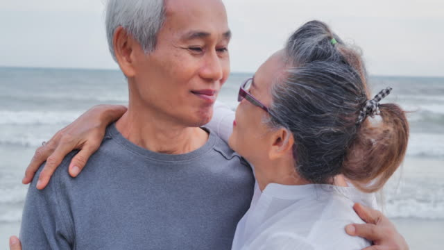 romantic senior couple on summer vacation.senior couple relaxing by the sea.senior holidays,vacations - grey hair stock videos & royalty-free footage