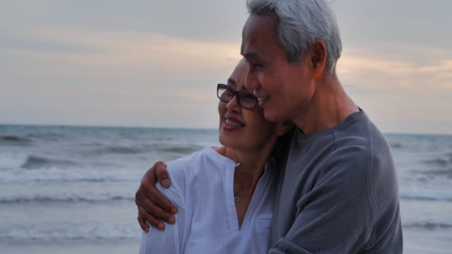 romantic senior couple on summer vacation.senior couple relaxing by the sea.senior holidays,vacations - married stock videos & royalty-free footage