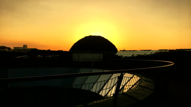 romantic sunset above city. rooftop view - romantic sky stock videos & royalty-free footage