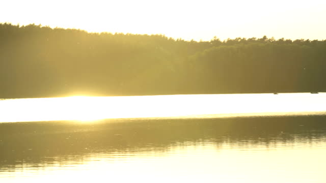 romantic sunset above lake. peaceful scenery - romantic sky stock videos & royalty-free footage