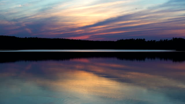 romantic sunset above lake. peaceful scenery with colorful clouds - romantic sky stock videos & royalty-free footage