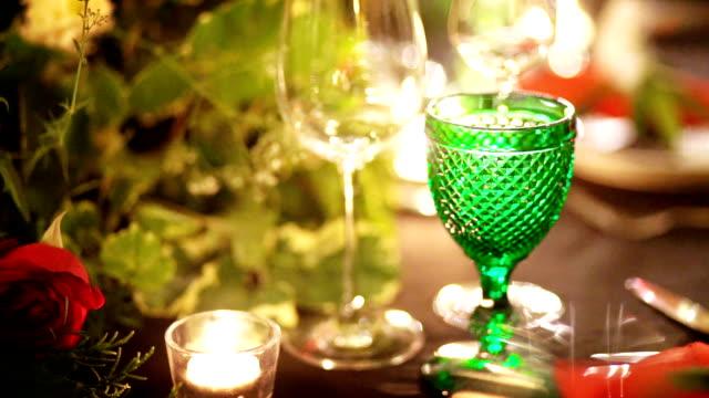 vídeos de stock e filmes b-roll de romantic table setup decorated for dinner party or wedding reception. - evento