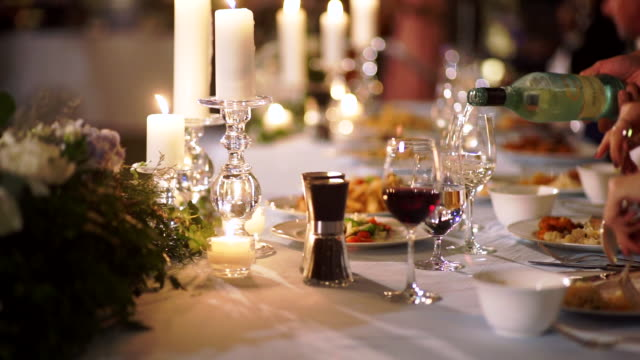 vídeos de stock e filmes b-roll de romantic table setup decorated for dinner party or wedding reception. - formal
