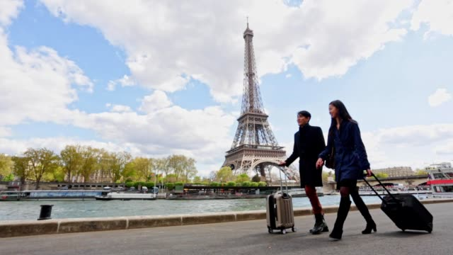 Romantic Young Asian Couple Walking in Paris