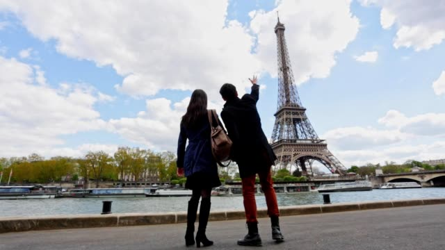 romantic young asian couple walking in paris - eiffel tower stock videos & royalty-free footage