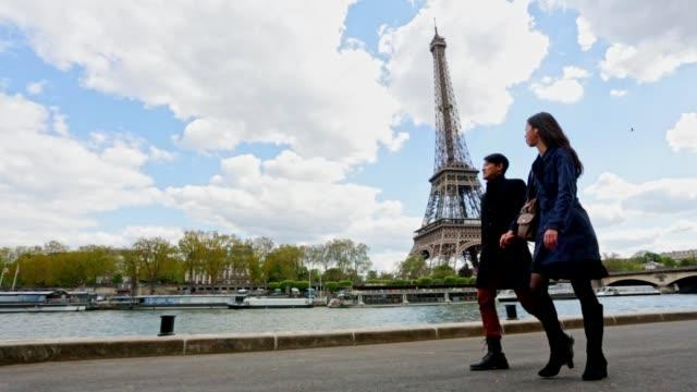 Romantic Young Asian Couple Walking in Paris