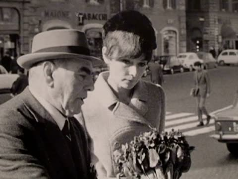 rome, 26 oct , .- few people are aware of audrey hepburn's day-to-day life: taking her children to school, buying flowers and walking her dog... - audrey hepburn stock videos & royalty-free footage