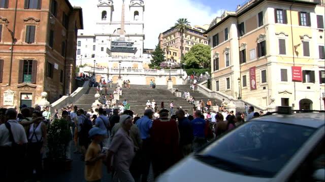 general views of campo dei fiori / trevi fountain / spanish steps / coliseum / jewish ghetto people sat on spanish steps with barcaccia fountain in... - ghetto video stock e b–roll