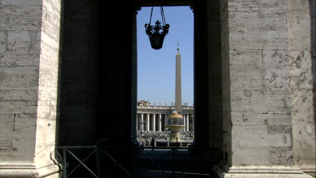 general views of st angelo's bridge / sunsets / early morning / vatican city / new fiat 500 nun walking along on pavement / lantern hanging in st... - facciata video stock e b–roll