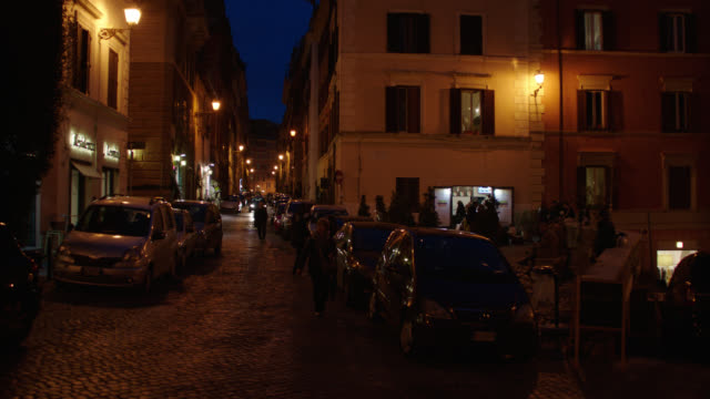 rome, italy residential street lined with apartment buildings - night - roman stock videos & royalty-free footage