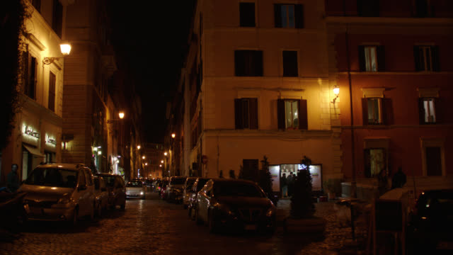 rome, italy residential street lined with apartment buildings - night - rome italy stock videos & royalty-free footage