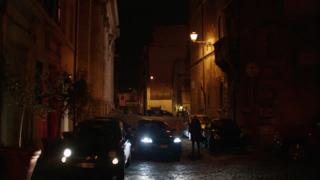 rome, italy residential street lined with various buildings - night - rome italy stock videos & royalty-free footage