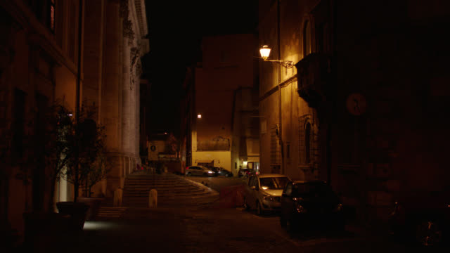 rome, italy residential street lined with various buildings - night - roman stock videos & royalty-free footage