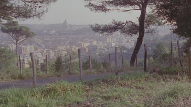h-d rome, italy; trees in f.g. - ラツィオ州点の映像素材/bロール