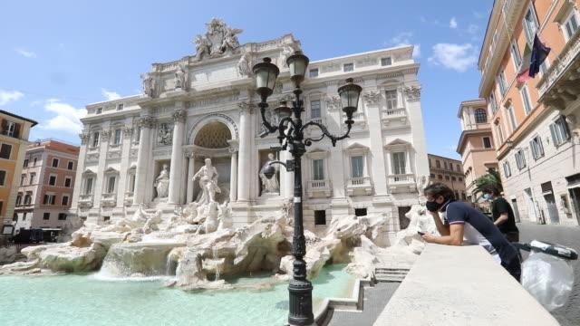 rome lockdown easing phase three rome italy on tuesday may 19 2020 - fontana struttura costruita dall'uomo video stock e b–roll