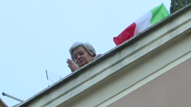 rome residents sing classic italian song 'bella ciao' from their windows and balconies as the city remains under lockdown to contain a coronavirus... - singing stock videos & royalty-free footage