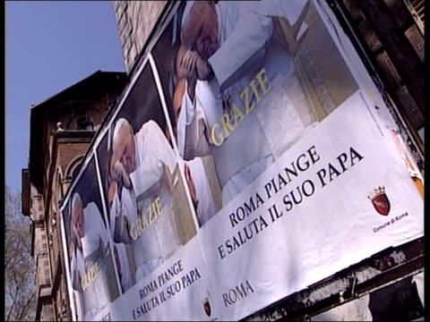 rome vatican city posters showing picture of pope john paul ii with 'grazie' message - pope john paul ii stock videos and b-roll footage