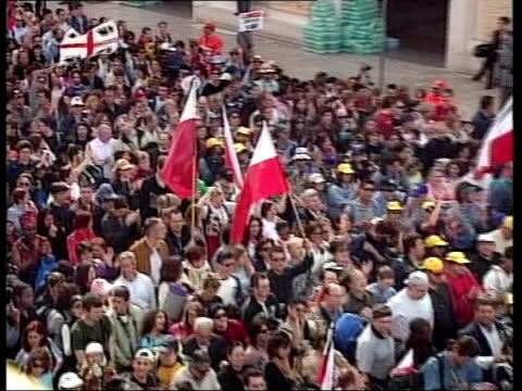 rome vatican city tgv crowds queuing to see pope bv people holding polish flags queuing banner held up by polish catholics in queue tgv crowd... - pope john paul ii stock videos & royalty-free footage