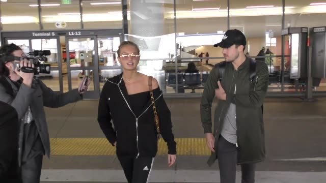 Romee Strijd Laurens van Leeuwen arriving at LAX Airport in Los Angeles in Celebrity Sightings in Los Angeles
