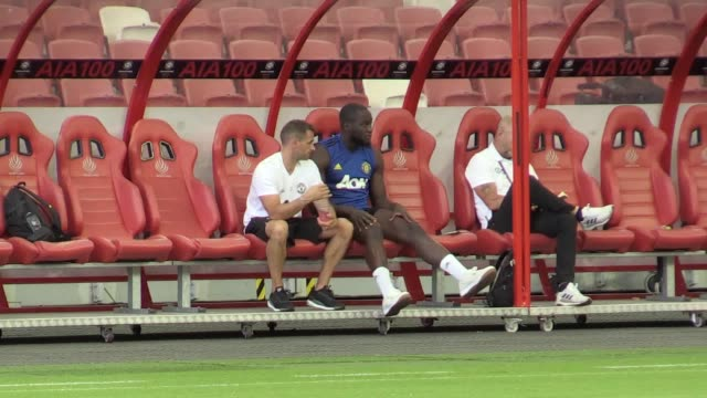 romelu lukaku sits out of manchester united's training session in singapore after picking up an injury earlier in the week the striker watched on as... - sitting stock videos & royalty-free footage