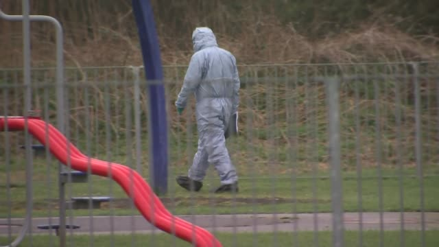 crime scene general views england london romford harold hill ext various of forensics officers working at playground where 17yearold girl was found... - 非常線点の映像素材/bロール