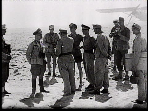vídeos de stock, filmes e b-roll de rommel and kesselring confer meet outside with other officers map of german advances in the middle east - áfrica do norte