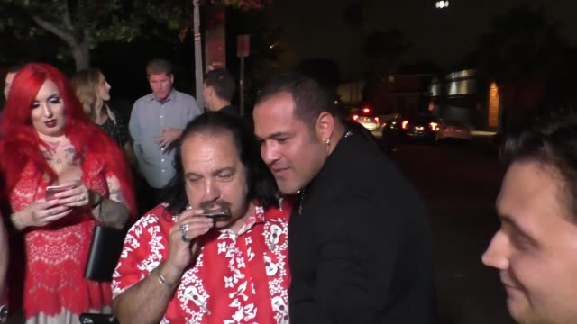 Ron Jeremy plays harmonica wedding song for a fan at the Vista Theatre in Hollywood at Celebrity Sightings in Los Angeles on June 03 2016 in Los...