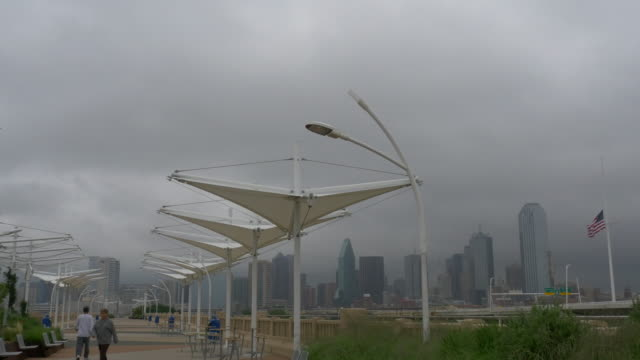 t/l ron kirk pedestrian bridge, storm clouds over downtown dallas, texas - storm cloud stock videos & royalty-free footage