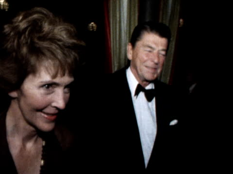 Ronald and Nancy Reagan and Sophia Loren arrive at a Hollywood dinner party in honour of Prince Charles' visit to California October 1977