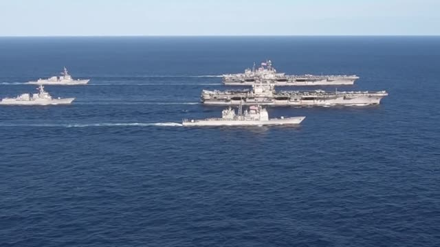 ronald reagan and uss john c stennis are transit the philippine sea as part of a dual carrier strike force exercise. - 米国海軍点の映像素材/bロール