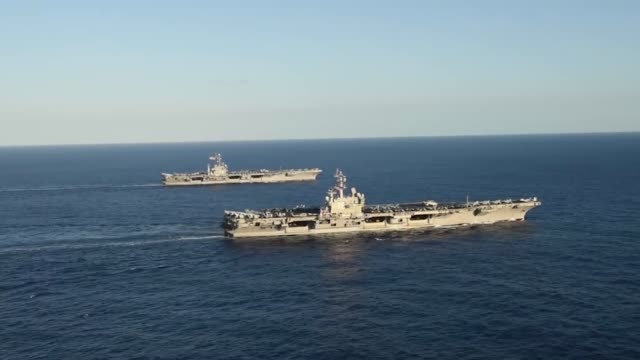 uss ronald reagan and uss john c stennis are transit the philippine sea as part of a dual carrier strike force exercise - warship stock videos & royalty-free footage