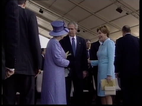 state funeral on friday pool france normandy president george w bush standing with queen elizaebth ii of great britain at celebration of 60th... - us president stock videos & royalty-free footage