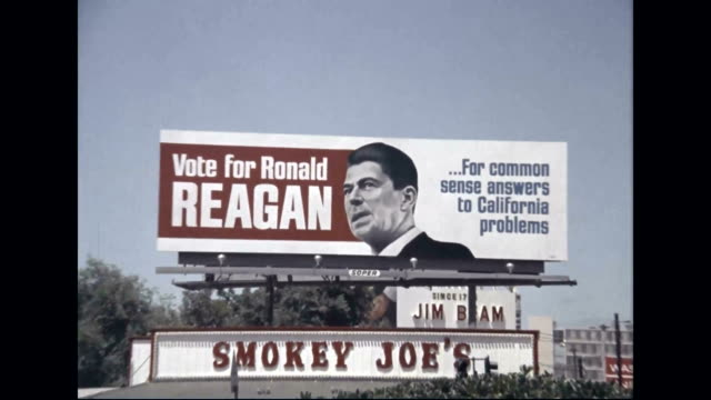 ronald reagan for governor billboard above smoky joe's sign - 長点の映像素材/bロール