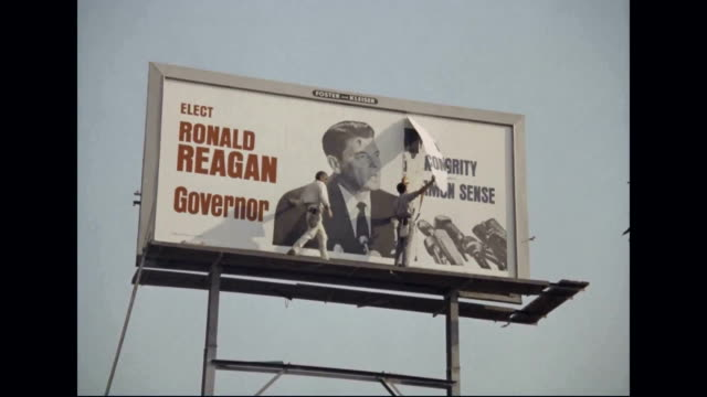 ronald reagan for governor billboard is taken down after election - 長点の映像素材/bロール