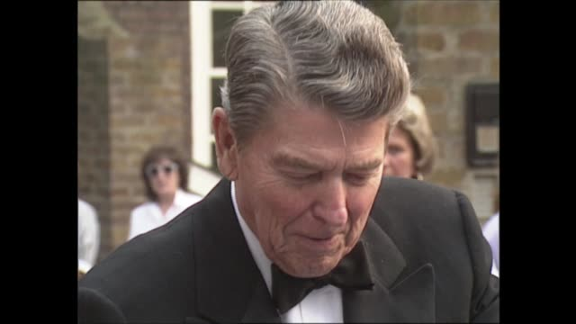 ronald reagan receives honorary knighthood england london battersea ronald reagan and wife nancy reagan arrive at home of malcolm forbes nancy and... - autographing stock videos & royalty-free footage