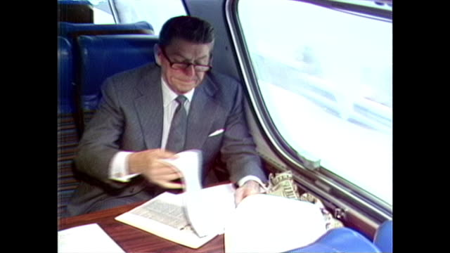 ronald reagan reviews paperwork while working on the campaign bus. - paperwork stock videos & royalty-free footage