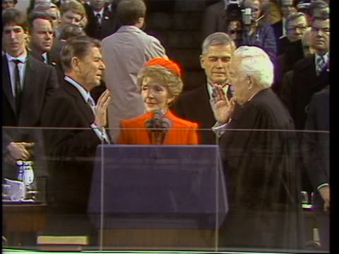 ronald reagan takes the oath of office at his first inauguration, as administered by chief justice warren e. burger. - oath stock videos & royalty-free footage