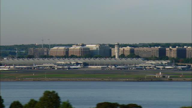 LOW AERIAL Ronald Reagan Washington National Airport seen across Potomac river, Washington D.C., USA