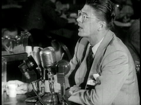 Ronald Reagan with eyeglasses testifying at HUAC hearings / newsreel