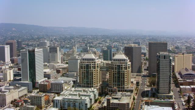 aerial ronald v. dellums federal building and the center of oakland, california - oakland california stock videos & royalty-free footage