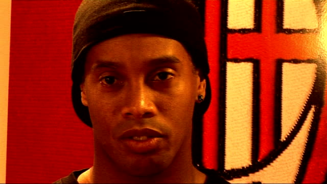 Ronaldinho interview Bishop very apologetically tells him the microphone is sensitive and he shouldn't play with it SOT Ronaldinho interview SOT...