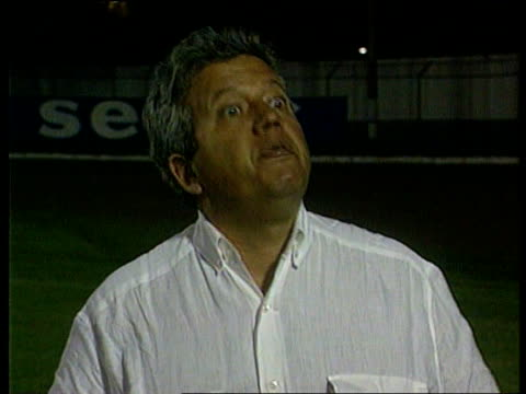 nike itn brazil rio de janiero at night joaquin da mata interviewed talks about pressure on the team children playing football on the beach people... - nike designer label stock videos and b-roll footage