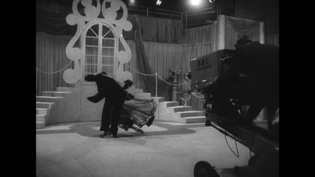 stockvideo's en b-roll-footage met ronnie boyer and jeanne ravel rehearse a dance at a temporary bbc studio at the national radio show - dance studio