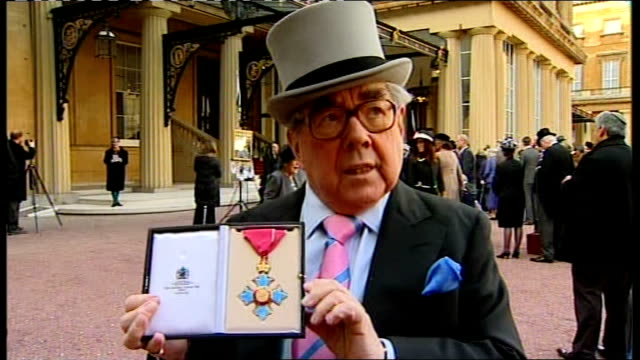 ronnie corbett awarded cbe ext corbett interview as showing cbe medal sot corbett holding up cbe award - ronnie corbett stock videos and b-roll footage