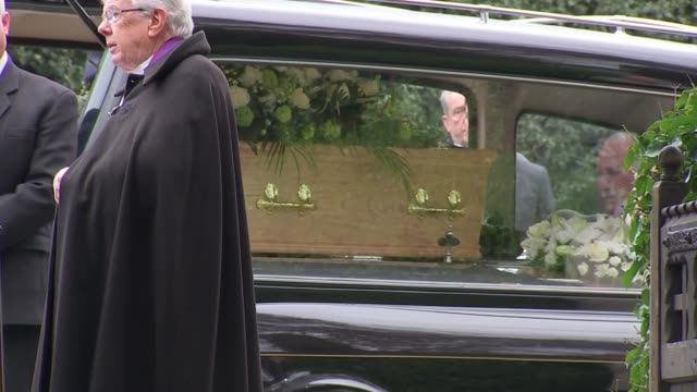 ronnie corbett funeral coffin into church / ronnie corbett's glasses on wreath closeup ronnie corbett's glasses on wreath - ronnie corbett stock videos and b-roll footage