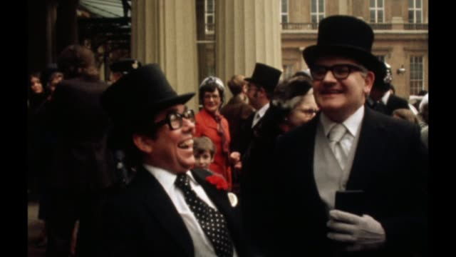 ronnie corbett funeral lib buckingham palace ext ronnie corbett and ronnie barker at buckingham palace at time of their investiture - ronnie corbett stock videos & royalty-free footage