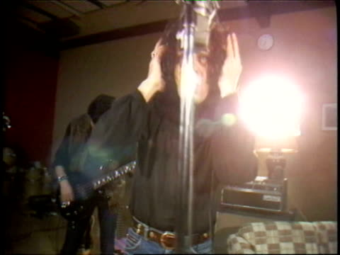 ronnie james dio in the studio recording the song shame on the night from the holy diver album ronnie james dio in the recording studio on january 23... - sound recording equipment stock videos & royalty-free footage