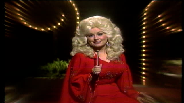 """ronnie milsap plays piano and parton thanks him for being on the show / """"well, dolly, all i've got to say is..."""" he stands up and unzips his shirt to... - t shirt stock videos & royalty-free footage"""