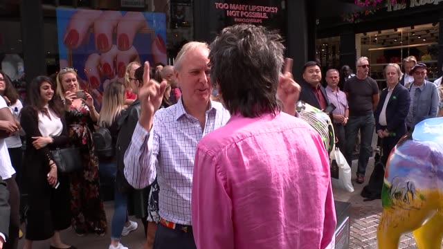 Ronnie Wood launches the Tusk Rhino Trail in London ENGLAND London Carnaby Street ANGLE shots of Ronnie Wood posing by Tusk rhino statues and...