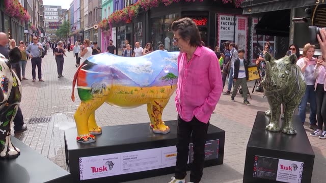 Ronnie Wood launches the Tusk Rhino Trail in London ENGLAND London Carnaby Street EXT Ronnie Wood posing with Tusk rhino sculptures and chatting to...